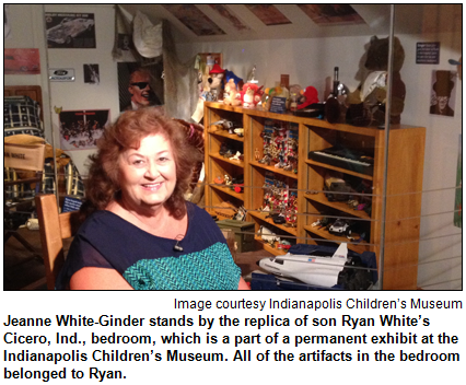 Jeanne White-Ginder stands by the replica of son Ryan White's Cicero, Ind., bedroom, which is a part of a permanent exhibit at the Indianapolis Children's Museum. All of the artifacts in the bedroom belonged to Ryan. Image courtesy Indianapolis Children's Museum.